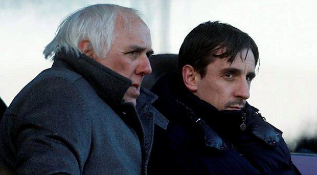 File photo dated 29/01/11 of Gary Neville in the stands with his father Neville Neville. PRESS ASSOCIATION Photo. Issue date: Friday August 7, 2015. Neville Neville, the father for former footballers Gary and Phil and England netball coach Tracey, has died in Australia, England Netball has announced