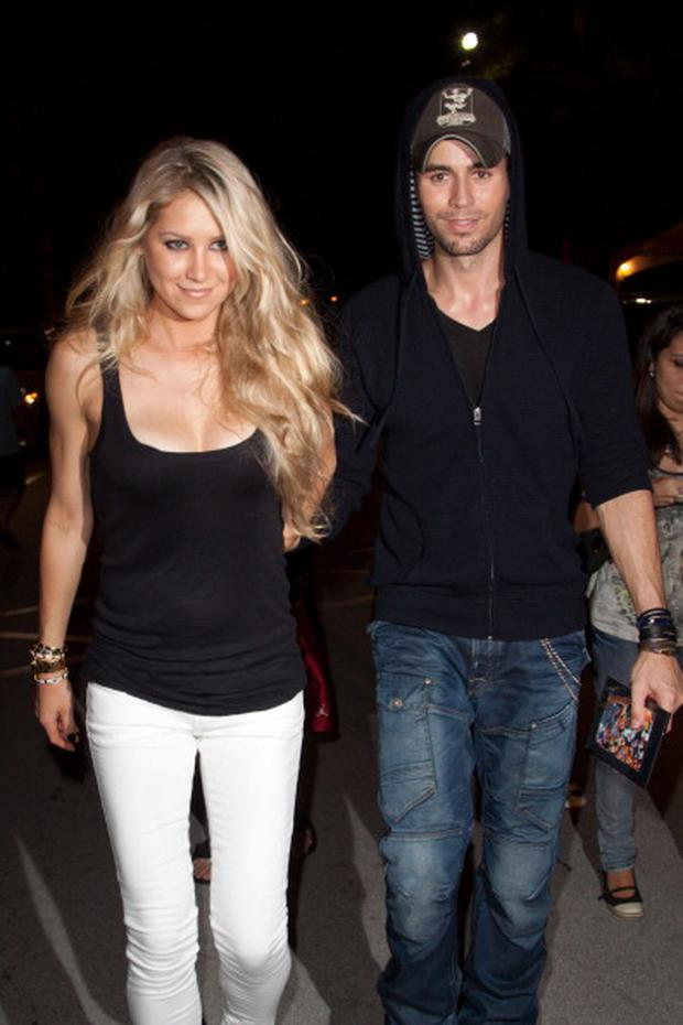 Anna Kournikova and Enrique Iglesias leave the Orange Carpet for the Miami Dolphins versus New York Jets game at Sun Life Stadium on September 26, 2010 in Miami, Florida.