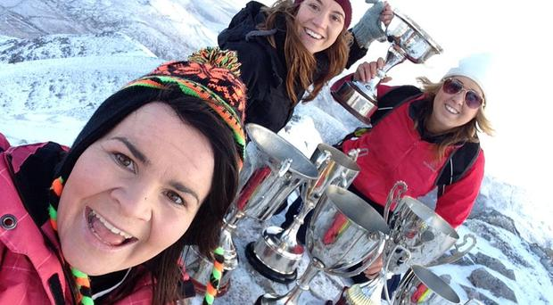 Termon's Geraldine McLaughlin (front), Grainne McDaid and Maureen O'Donnell brought their clean sweep of trophies in 2014 to the top of Donegal's highest mountain Mt Errigal to celebrate All-Ireland club glory.