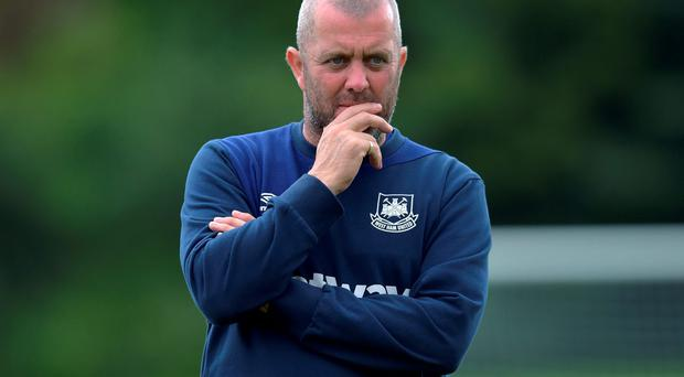 Assistant coach Julian Dicks watches on during the West Ham United fitness session taking place at their training camp