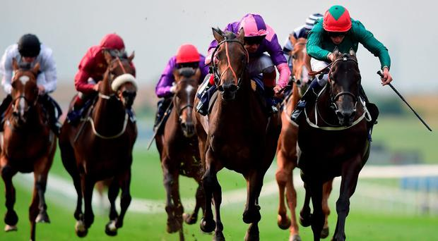 Montsarrat ridden by William Buick (right) wins at Newmarket yesterday