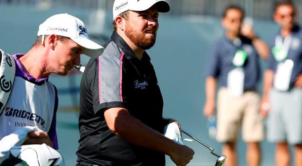 Shane Lowry walks onto the green of the eighteenth hole during the second round of the World Golf Championships - Bridgestone Invitational at Firestone