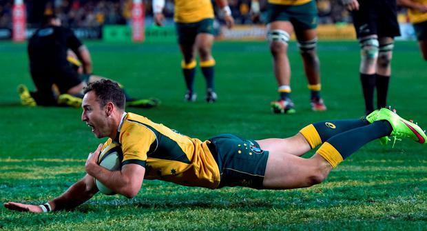 Australia's Nic White scores a try against the New Zealand All Blacks during the Bledisloe Cup