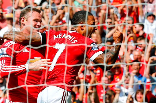 Football - Manchester United v Tottenham Hotspur - Barclays Premier League - Old Trafford - 8/8/15 Memphis Depay and Wayne Rooney celebrates after Tottenham's Kyle Walker scored an own goal and the first goal for Manchester United Action Images via Reuters / Darren Staples Livepic EDITORIAL USE ONLY. No use with unauthorized audio, video, data, fixture lists, club/league logos or