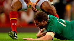8 August 2015; Darren Cave, Ireland, scores his side's second try. Rugby World Cup Warm-Up Match, Wales v Ireland, Millennium Stadium, Cardiff, Wales. Picture credit: Brendan Moran / SPORTSFILE