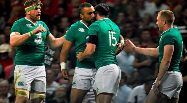 Ireland's Felix Jones, second right, is congratulated by team-mates Jamie Heaslip, Simon Zebo and Keith Earls after scoring a try. Rugby World Cup Warm-Up Match, Wales v Ireland, Millennium Stadium, Cardiff, Wales. Picture credit: Ramsey Cardy / SPORTSFILE