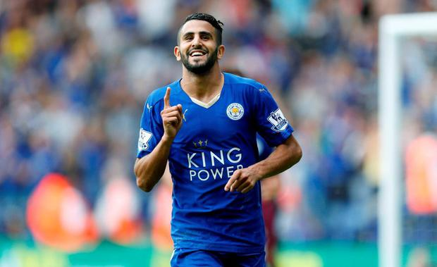 Leicester City's Riyad Mahrez celebrates scoring his side's third goal during the Barclays Premier League match at the King Power Stadium