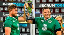 Ireland's Jamie Heaslip, left, and Mike Ross lift the trophy following their side's victory