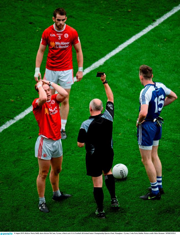 Referee Marty Duffy shows Kieran McCann, Tyrone, a black card. GAA Football All-Ireland Senior Championship Quarter-Final, Monaghan v Tyrone, Croke Park, Dublin. Picture credit: D?ire Brennan / SPORTSFILE