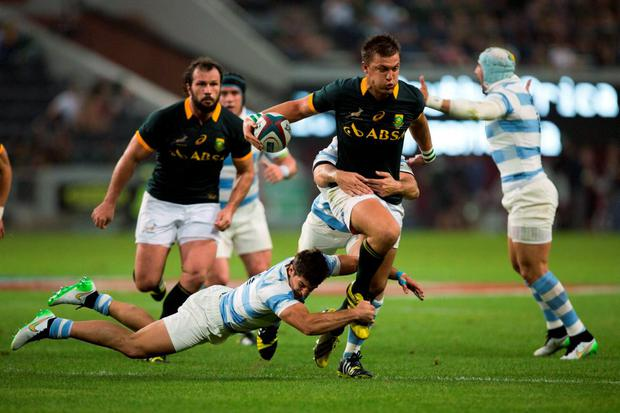 South Africa's Handre Pollard is tackled by Argentina's Tomas Cubelli (L) and Leonardo Senatore (partially obscured, C) during their Championship rugby union test match in Durban, August 8 2015. REUTERS/Rogan Ward