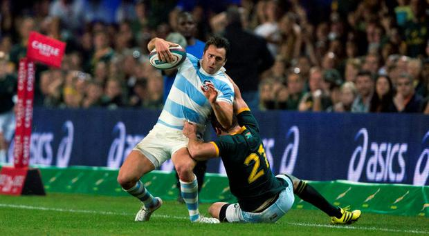 Argentina's Juan Imhoff is tackled by South Africa's Cobus Reinach during their Championship rugby union test match in Durban, August 8 2015. REUTERS/Rogan Ward