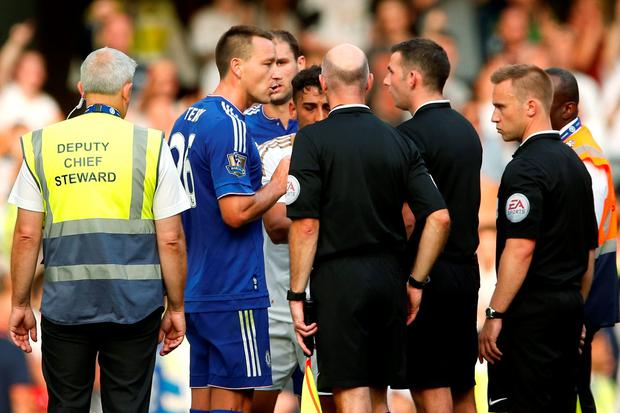Chelsea's John Terry remonstrates with referee Michael Oliver after the game