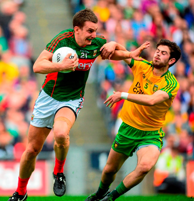 8 August 2015; Barry Moran, Mayo, in action against Ryan McHugh, Donegal. GAA Football All-Ireland Senior Championship Quarter-Final, Donegal v Mayo, Croke Park, Dublin. Picture credit: Piaras ? M?dheach / SPORTSFILE