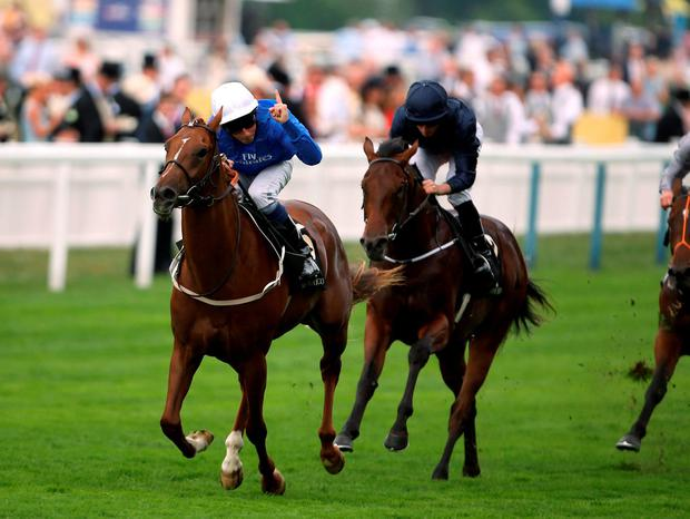 Buratino (left) ridden by jockey William Buick on their way to winning the Coventry Stakes