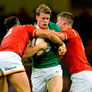 Ireland's Andrew Trimble is tackled by Welsh duo Dan Baker and Scott Williams during yesterday's Rugby World Cup warm-up match at the Millennium Stadium.