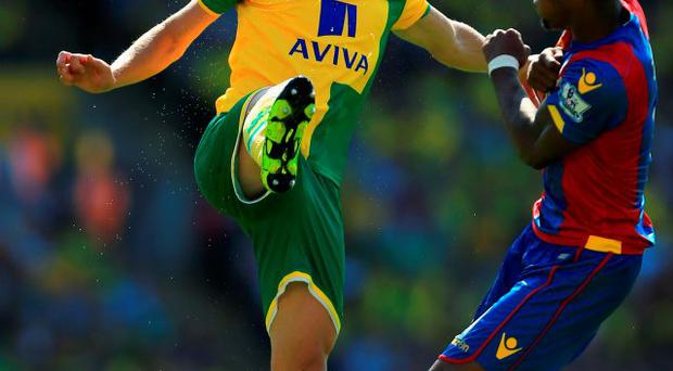 Norwich's Steven Whittaker battles with Wilfried Zaha for the ball