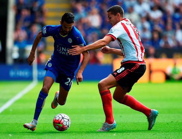 Leicester City's Riyad Mahrez tussles with Jack Rodwell of Sunderland