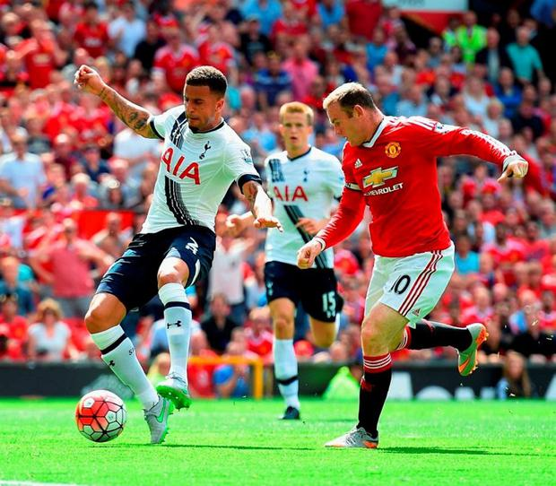 Tottenham's Kyle Walker diverts the ball into his own net as Wayne Rooney looks on at Old Trafford yesterday