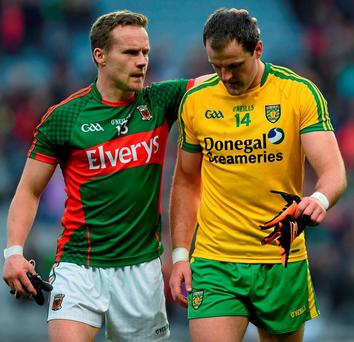 Mayo's Andy Moran consoles Donegal's Michael Murphy after last night's game at Croke Park
