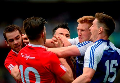 Monaghan players Kieran Hughes and Conor McManus in a tussle with Tyrone players Ronan McNamee and Tiernan McCann during yesterday's All-Ireland SFC quarter-final at Croke Park