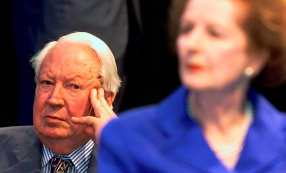 Glaring at his nemesis: Ted Heath looks at the woman who brought him down as Tory leader, Margaret Thatcher, a happening which led to a 30-year sulk