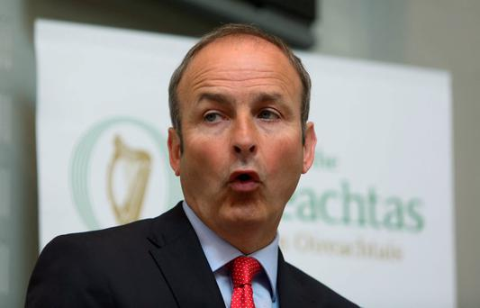Disagreement: Fianna Fail leader Micheal Martin believes that Denis O'Brien has the right to make his legal challenge, but that he should not avail of that right