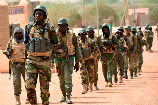 Soldiers of the Malian Army Forces and the French 93rd Mountain Artillery Regiment patrolling in Goundam, in the Timbuktu region