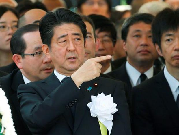 Japan's Prime Minister Shinzo Abe attends a ceremony commemorating the 70th anniversary of the 1945 atomic bombing of the city at Nagasaki's Peace Park in Nagasaki, western Japan, August 9, 2015. REUTERS/Toru Hanai