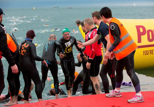 Some of the competitors getting out of the water in Dublin's first Ironman 70.3 triathlon, with 2,500 athletes taking part. The course involves a 1.9km swim at Scotsman's Bay in D?n Laoghaire, followed by a 90km cycle which goes through Dublin city before looping back to Phoenix Park where the race will conclude with a 21km half marathon. 9/8/2015 Picture by Fergal Phillips
