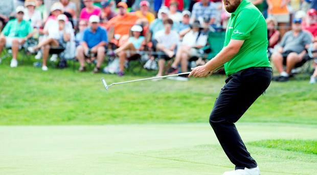 Shane Lowry reacts after missing a putt on the eighteenth hole at Firestone