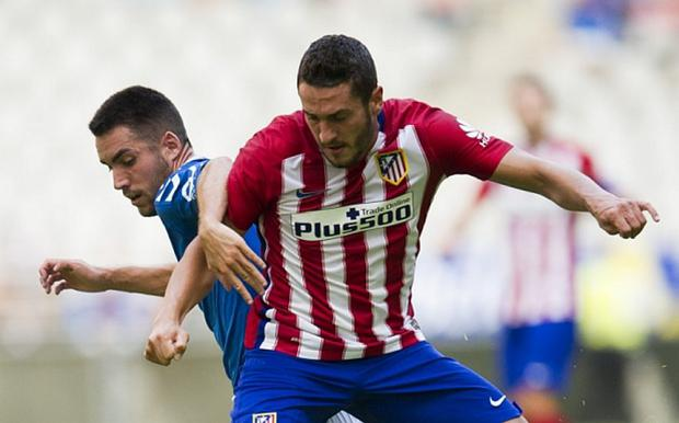 Koke holding off a challenge, as Atletico hold off a bid for him Photo: GETTY