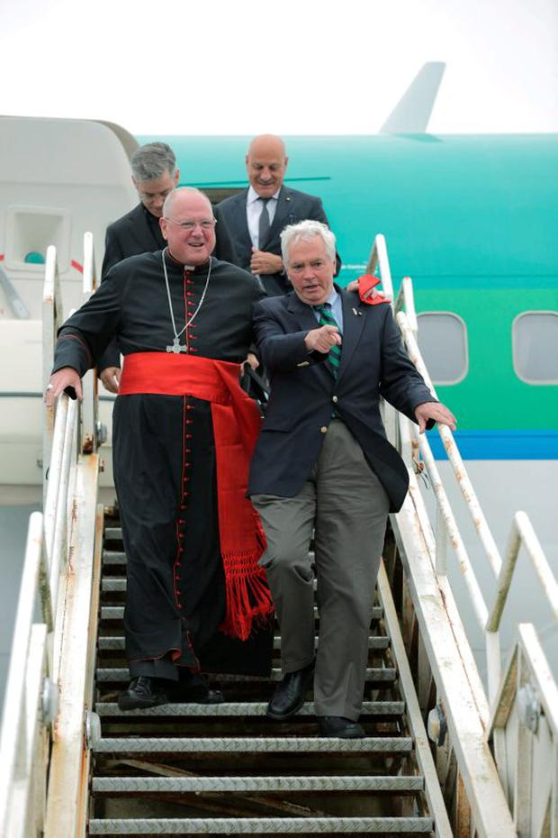 09/08/2015 Cardinal TImothy Dolan, Archbishop of New York and Brian O'Dwyer, International Chairman of Ireland West Airport Knock arriving on the Aer Lingus flight carrying pilgrims from New York to Knock Shrine. Photo : Keith Heneghan / Phocus