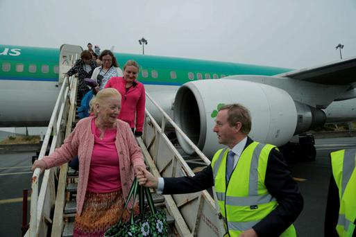 An Taoiseach Enda Kenny welcoming passengers on the Aer Lingus flight carrying pilgrims from New York to Knock Shrine landing in Ireland West Airort Knock. Photo : Keith Heneghan / Phocus