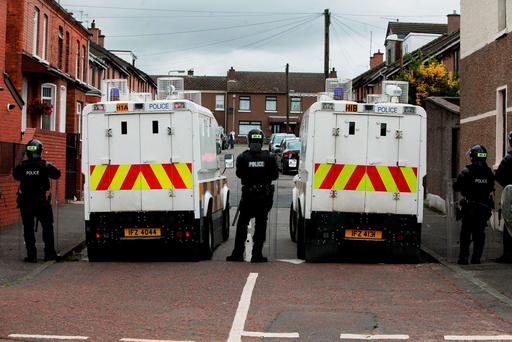 PSNI officers and vehicles in Belfast, as a major security operation is under way in the city centre ahead of a contentious republican parade and related loyalist protests Credit: Stephen Kilkenny/PA Wire