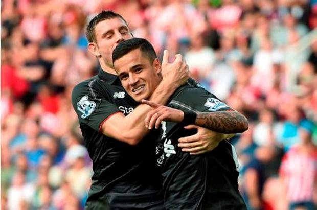 Liverpool's Philippe Coutinho (right) celebrates scoring his side's winner