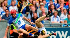 Tadhg De Burca, Waterford, in action against Colin Fennelly