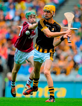 Kilkenny goalkeeper Shane Murphy attempts to clear the ball under pressure from Galway's Brian Concannon in the Electric Ireland MHC semi-final