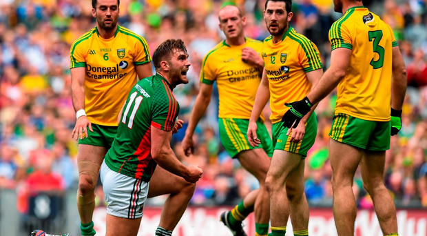 Mayo's Aidan O'Shea celebrates winning a free against Donegal's Neil McGee