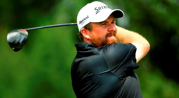 Shane Lowry tees off at the fourth during the final round of the Bridgestone Invitational at Firestone Country Club