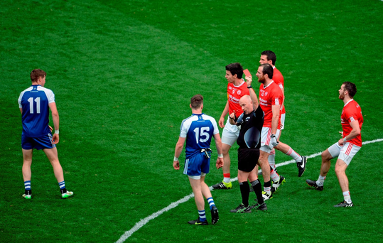 Referee Marty Duffy gives Darren Hughes (11) the red card late on in their defeat against Tyrone