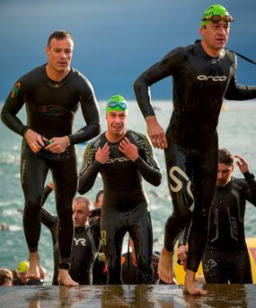 Some of the competitors getting out of the water after swimming in Scotsman's Bay