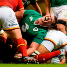 Ireland's Jack McGrath reacts under pressure in a ruck during Saturday's game against Wales at the Millennium Stadium