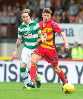 Celtic's Stefan Johansen (left) and Partick Thistle's Gary Fraser battle for the ball