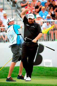 Shane Lowry of Ireland (R) celebrates with his caddie Dermot Byrne after a birdie putt on the 18th green during the final round of the World Golf Championships - Bridgestone Invitational at Firestone Country Club South Course on August 9, 2015 in Akron, Ohio. (Photo by Sam Greenwood/Getty Images)