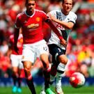 Chris Smalling takes care of Spurs attacker Harry Kane