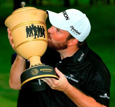 Shane Lowry lifts the WGC Bridgestone Invitational Trophy in Ohio last night