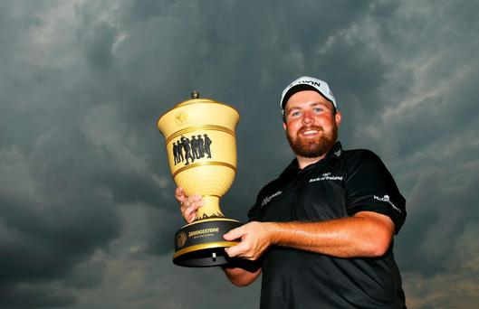 Shane Lowry holds the Gary Player Cup after winning the World Golf Championships - Bridgestone Invitational during the final round at Firestone Country Club South Course
