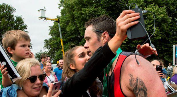 Niall Breslin (Bressie) who completed the Dublin's first Ironman 70.3 triathlon in Phoenix Park today, with 2,500 athletes taking part with girlfriend Roz Purcell after the race