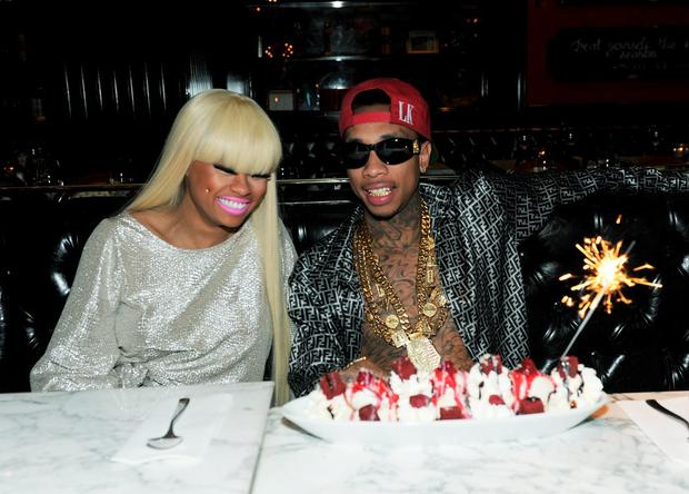 Blac Chyna and Tyga during his birthday dinner at Sugar Factory American Brasserie on November 18, 2011 in Las Vegas, Nevada. (Photo by Denise Truscello/WireImage)
