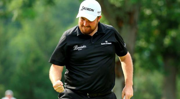 Shane Lowry reacts after a par putt during the final round of the World Golf Championships - Bridgestone Invitational at Firestone Country Club